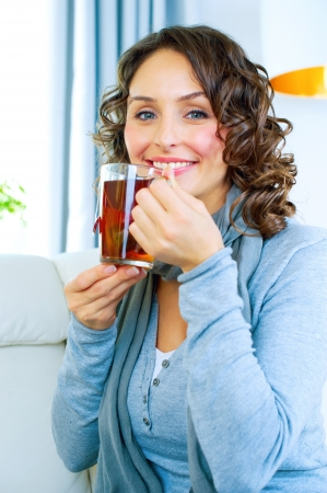 woman drinking tea: Beautiful Young Woman drinking hot tea
