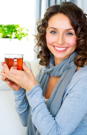 Beautiful Young Woman drinking hot tea  photo