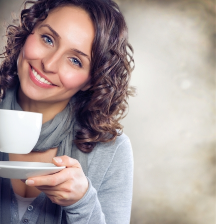 Beautiful Woman with cup of Tea or Coffee Stock Photo - 11131217