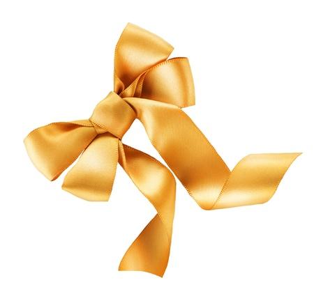 Bow. Golden satin gift bow. Ribbon. Isolated on white  photo