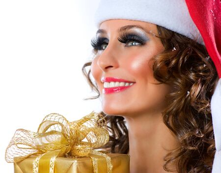 Christmas. Santa girl with Gift box  photo