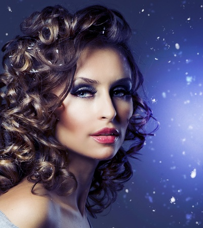 Fashion Beauty Portrait. Healthy Hair. Hairstyle. Holiday Makeup  photo