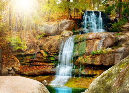 Waterfall in forest. Autumn  photo