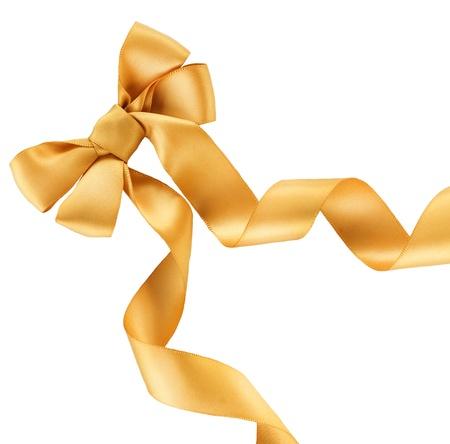golden ribbon: Bow. Golden satin gift bow. Ribbon. Isolated on white