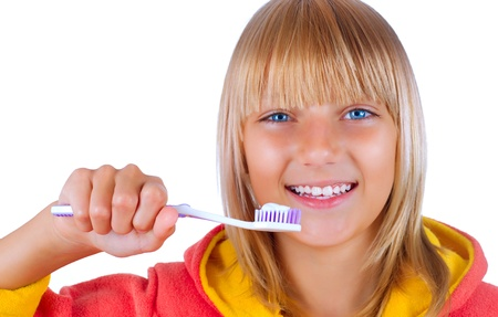 Healthy Teeth. Little Girl brushing her teeth photo