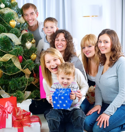 Happy Big family holding Christmas presents at home Stock Photo - 11329975