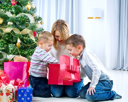 Children with Christmas gifts. Christmas tree  photo