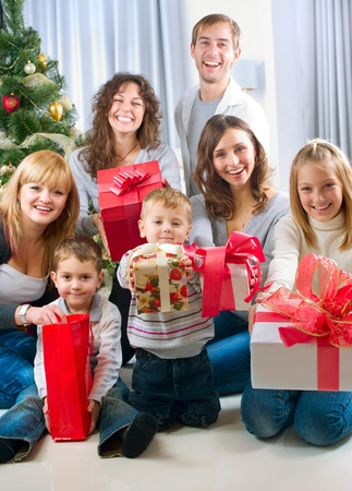Happy Big family holding Christmas presents at home  photo