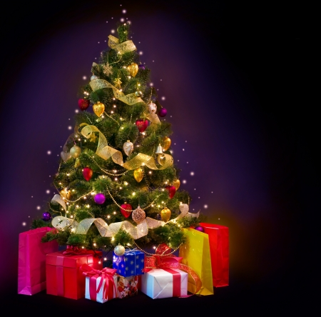 Christmas Tree with Gifts isolated on black photo