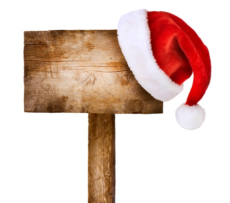Wooden sign with Santa hat isolated on white photo