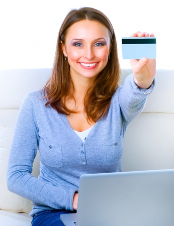 Smiling Woman shopping online with credit card. E-shopping photo