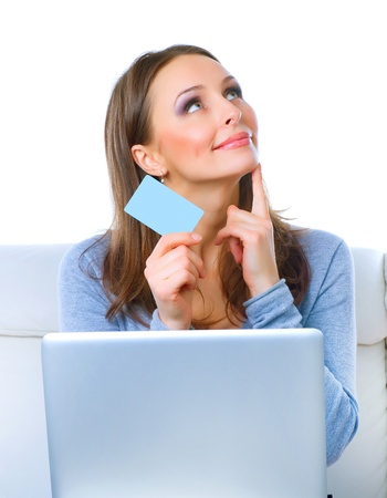 Smiling Woman shopping online with credit card. E-shopping Stock Photo - 12039795