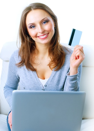 Smiling Woman shopping online with credit card. E-shopping Stock Photo - 12039802