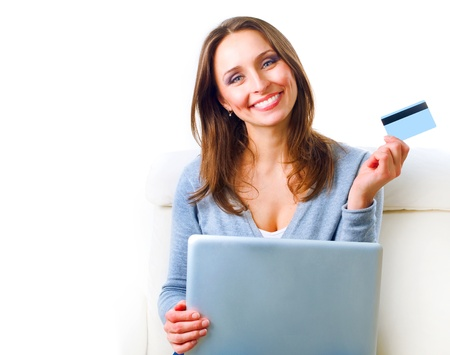 buy online: Smiling Woman shopping online with credit card. E-shopping
