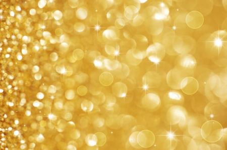 金: クリスマスのキラキラの背景。ホリデイ ゴールドの抽象的なテクスチャ 写真素材