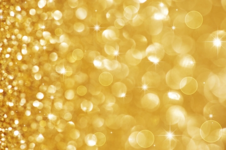 sparkles: Christmas Glittering background. Holiday Gold abstract texture