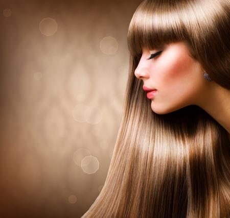 Blondes Haar. Sch�ne Frau mit geradem Long Hair Lizenzfreie Bilder