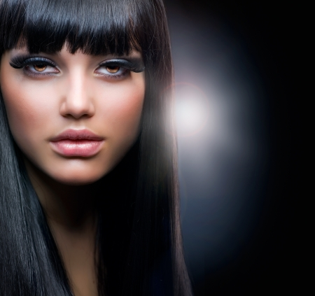 Fashion Brunette. Beautiful Makeup and Healthy Black Hair