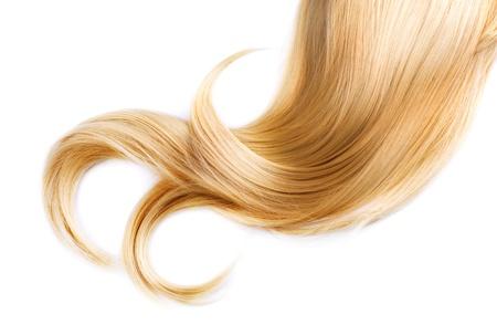 人間の髪の毛: 白で隔離される健全なブロンドの髪