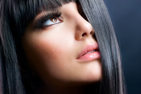 Fashion Brunette. Beautiful Makeup and Healthy Black Hair photo