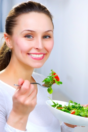 Diet. Healthy Young Woman Eating Vegetable Salad   photo