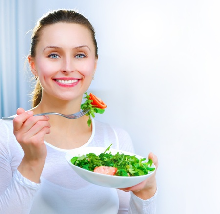 Diet. Healthy Young Woman Eating Vegetable Salad Zdjęcie Seryjne
