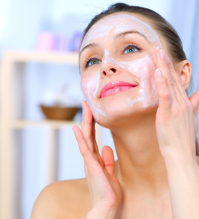 Beautiful Woman Applying Natural Homemade Facial Mask Stock Photo - 12382091