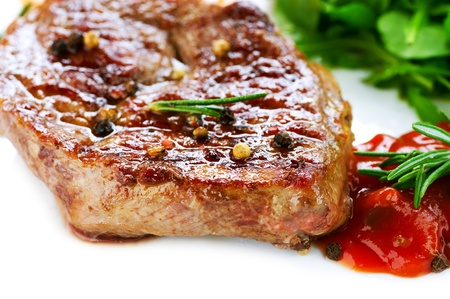 medium close up: Grilled Beef Steak Isolated On a White Background