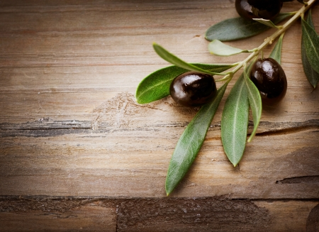 olive trees: Olives on a Wood background  Stock Photo