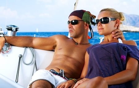 Beautiful Couple resting on the Yacht  photo