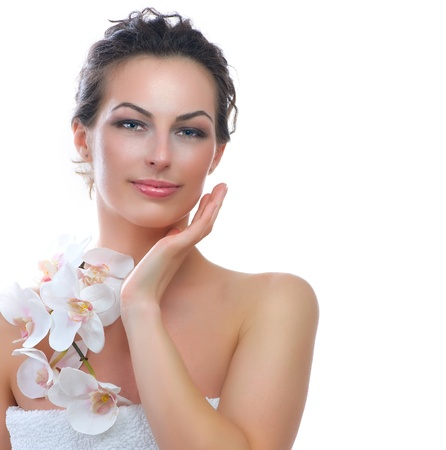 white orchid: Beautiful Spa Woman touching her Face  Healthy Skin  Stock Photo
