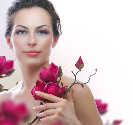 the magnolia: Beautiful Healthy Woman with Spring Flowers  Spa Stock Photo