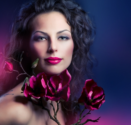 beauty salon face: Fashion Woman With Magnolia Spring Flowers  Stock Photo