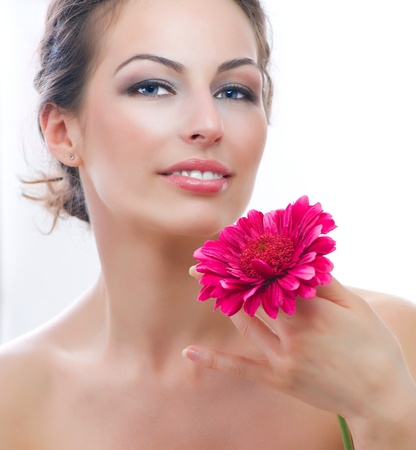 Beautiful Young Woman Portrait with Red Gerbera Flower  Spa photo