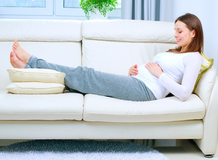 lovely pregnant woman: Pregnant Young Woman at home  Happy Pregnancy