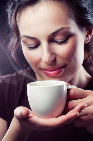 steam mouth: Beauty Girl With Cup of Coffee or Tea