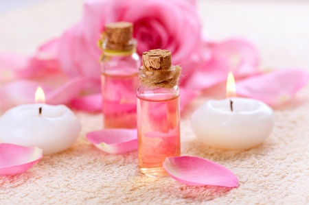scented candle: Bottles of Essential Oil for Aromatherapy  Rose Spa