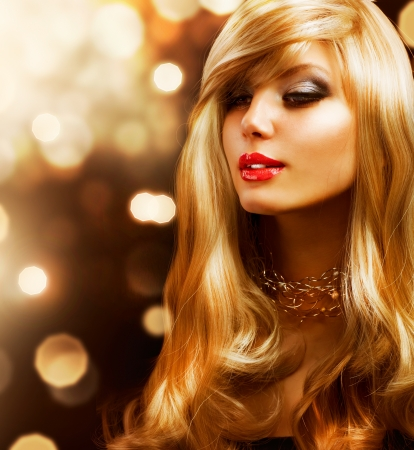 Blond Fashion Girl  Blonde Hair  Golden background  photo
