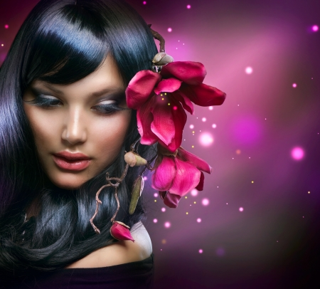 the magnolia: Fashion Brunette Girl with Magnolia Flowers  Stock Photo