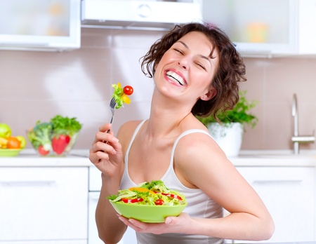 Diet  Beautiful Young Woman Eating Vegetable Salad  Stock Photo - 13064623
