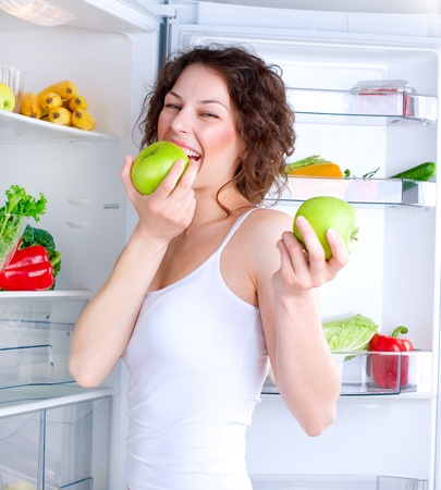 Beautiful Young Woman near the Refrigerator with healthy food  Stock Photo - 13064551