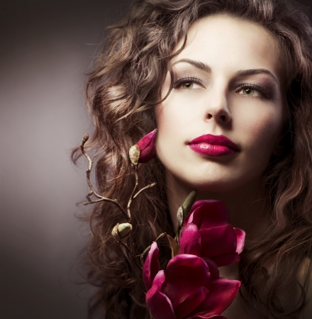 Fashion Woman With Magnolia Spring Flowers  Sepia Toned Stock Photo - 13066019