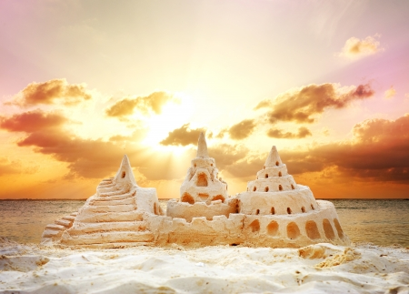 Sand Castle over Sunset on the Beach  photo