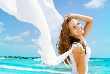 Beautiful Girl With White Scarf on The Beach  photo