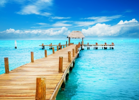 Vacation in Tropic Paradise  Jetty on Isla Mujeres, Mexico Stock Photo