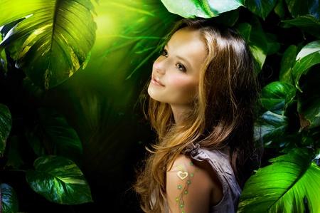 miracle leaf: Beautiful Girl in Jungle  Stock Photo