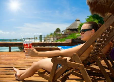 blue bikini: Young Woman on the Beach