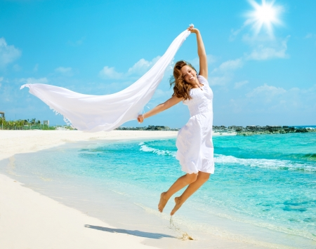 woman beach dress: Beautiful Girl Having Fun on the Beach
