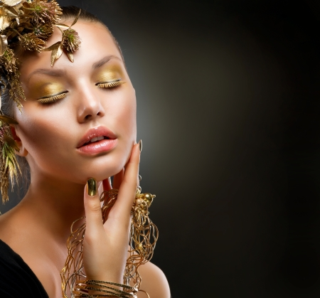 pesta�as postizas: Casa de Oro Maquillaje Moda Chica Retrato Foto de archivo