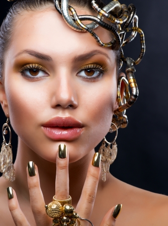 jewelery: Golden Makeup and Jewelry  Fashion Model Portrait  Stock Photo